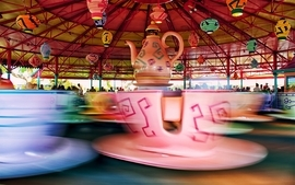 Multicolor parks mad tea party spincups wallpaper