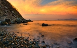 Sunset beach rocks seascapes wallpaper