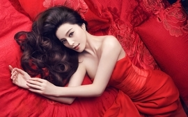 Women beds asians pillows red dress curly hair lying down wallpaper