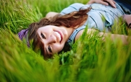 Women jeans eyes redheads grass models meadow smiles lying down wallpaper